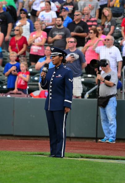 U.S. Air Force Airman 1st Class Sierra Bailey, a vocalist with the U.S. Air Force Heartland of America Band, sings the National Anthem during the Omaha Storm Chaser's military appreciation night at Werner Park in Papillion, Nebraska Aug. 7.  The Storm Chasers are the Triple-A affiliate of the Kansas City Royals.  (U.S. Air Force photo by Josh Plueger)