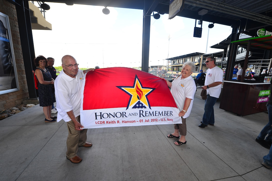 James and Mary Ann Hanson of Fremont Nebraska display their Gold Star Family flag in memory of their son, Lt. Cmdr. Keith Hanson, at Werner Park in Papillion, Neb. Aug. 7 for military appreciation night.  Werner Park is home to the Omaha Storm Chasers, the Triple-A affiliate of the Kansas City Royals.  (U.S. Air Force photo by Josh Plueger)
