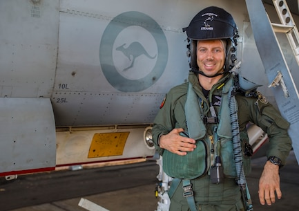 U.S. Marine Corps Maj. Alexander Goodno, Marine exchange pilot with the Royal Australian Air Force No. 75 Squadron, poses next to an F/A-18 Hornet during Exercise Pitch Black 16 at RAAF Base Tindal, Australia, Aug. 5, 2016. Goodno has been stationed with No. 75 Squadron for two and a half years with the Marine Corps Foreign Personnel Exchange Program. This program enhances worldwide security cooperation by continuing long-term presence and association among military counterparts. Goodno serves as a liaison officer to the participating U.S. units, explaining foreign jargon and procedures. (U.S. Marine Corps photo by Cpl. Nicole Zurbrugg)