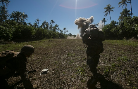 A U.S. Marine and Tongan soldier sprint toward the objective, exploiting high explosives used to clear an obstacle during a live-fire range, July 27, 2016, on Motutapu Island, Tonga, as part of a multi-national, bilateral exercise designed to increase interoperability and relations. The service members combined and applied skills practiced during the exercise in a culminating range such as buddy rushing, demolition, high explosive exploitation and buddy rushing. The Marines are with Task Force Koa Moana and are originally assigned to I Marine Expeditionary Force and III MEF.