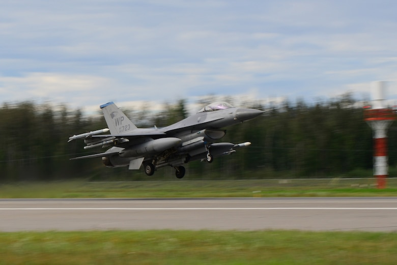 A U.S. Air Force F-16 Fighting Falcon aircraft assigned to the 35th Fighter Squadron, Kunsan Air Base, Republic of Korea, launches from the Eielson Air Force Base, Alaska flight line in preparation for a morning sortie Aug. 8, 2016, during RED FLAG-Alaska 16-3. Exercise scenarios occur within the Joint Pacific Alaska Range Complex, a more than 67,000 square mile airspace with minimal impact on the environment. (U.S. Air Force photo by Airman 1st Class Cassandra Whitman)