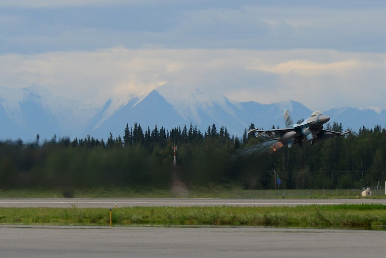 A U.S. Air Force F-16 Fighting Falcon aircraft assigned to the 18th Aggressor Squadron, takes off from Eielson Air Force Base, Alaska, for a mission Aug. 8, 2016, during RED FLAG-Alaska (RF-A) 16-3. RF-A enables joint and international units to sharpen their combat skills by flying simulated combat sorties in a realistic threat environment, which allows them to exchange tactics, techniques and procedures while improving interoperability. (U.S. Air Force photo by Airman 1st Class Cassandra Whitman)