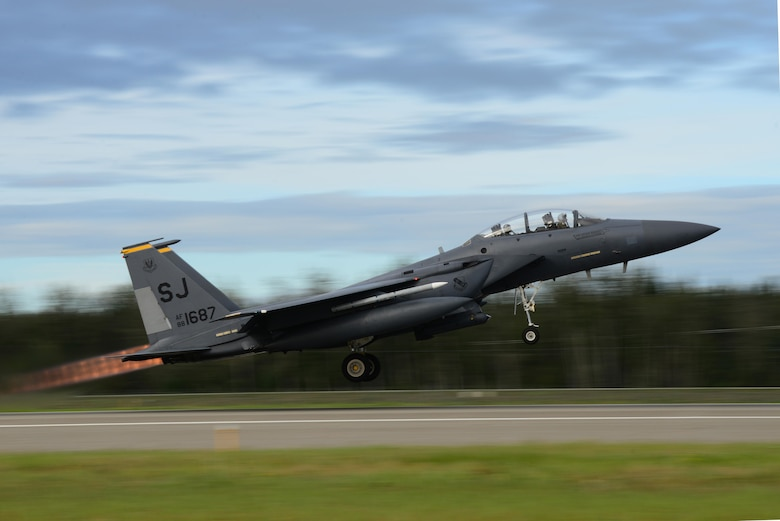 A U.S. Air Force F-15E Strike Eagle dual-role fighter aircraft assigned to the 336th Fighter Squadron out of Seymour Johnson Air Force Base, N.C., takes off from the Eielson Air Force Base, Alaska, flight line Aug. 8, 2016, during RED FLAG-Alaska 16-3. This exercise provides unique opportunities to integrate various forces into joint, coalition and multilateral training from simulated forward operating bases. (U.S. Air Force photo by Airman 1st Class Cassandra Whitman)