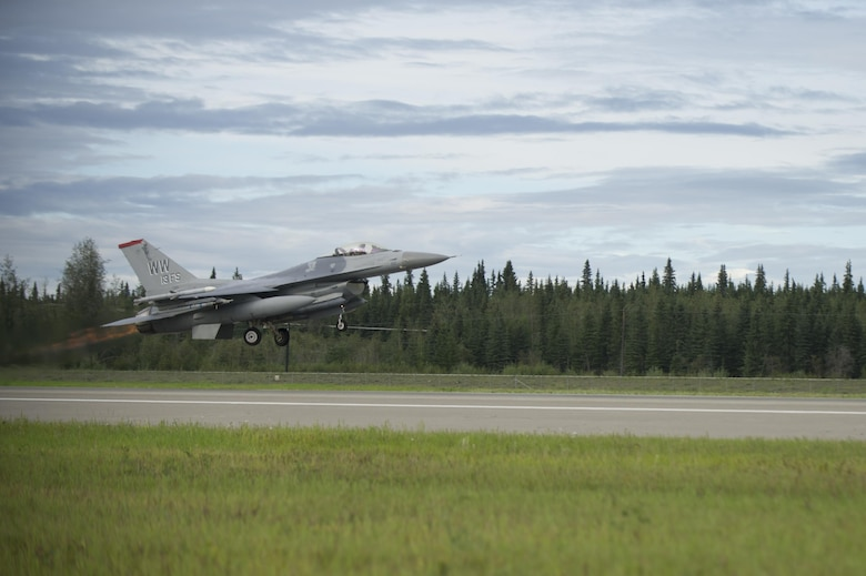 A U.S. Air Force F-16 Fighting Falcon aircraft assigned to the 13th Fighter Squadron, Misawa Air Base, Japan, launches from Eielson Air Force Base, Alaska, for a morning sortie Aug., 8, 2016, during RED FLAG-Alaska 16-3. Conducting RED FLAG training in Alaska signifies the United States' continued commitment to the Indo-Asia-Pacific region. (U.S. Air Force photo by Airman Isaac Johnson)
