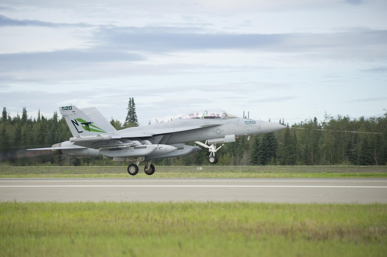 A U.S. Navy EA-18G Growler aircraft assigned to Electronic Attack Squadron 135, Naval Air Station Whidbey Island, Wash., takes off from Eielson Air Force Base, Alaska, for a morning sortie Aug., 8, 2016, during RED FLAG-Alaska 16-3. This exercise provides unique opportunities to integrate various forces into joint, coalition and multilateral training from simulated forward operating bases. (U.S. Air Force photo by Airman Isaac Johnson)