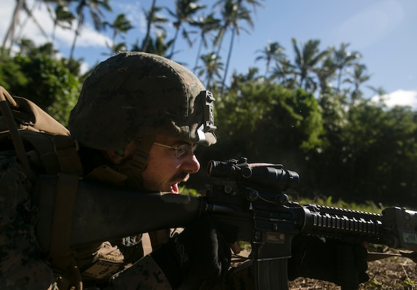 Lance Cpl. Jake A. Nolan shouts commands as a fire-team leader during a live-fire range, July 27, 2016, on Motutapu Island, Tonga, as part of a multi-national, bilateral exercise, between U.S. and Tongan forces, designed to increase interoperability and relations. The service members combined and applied skills practiced during the exercise in a culminating range such as demolition, high explosive exploitation, beach insertion and buddy rushing. Nolan, from Concord, North Carolina, is an infantryman with Task Force Koa Moana and is originally assigned to Company A, 1st Battalion, 1st Marine Regiment, 1st Marine Division, I Marine Expeditionary Force. (U.S. Marine Corps photo by Sgt. William Hester/ Released)