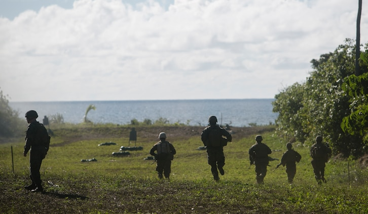 U.S. Marine infantrymen, combat engineers and Tongan soldiers sprint toward an obstacle to prepare a demolition charge to clear a path, July 27, 2016, on Motutapu Island, Tonga, as part of a multi-national, bilateral exercise designed to increase interoperability and relations. The service members combined skills practiced during the exercise into a culminating range such as beach insertion, buddy rushing, demolition and high explosive exploitation. The infantrymen and engineers are with Task Force Koa Moana. The infantrymen are originally assigned to 1st Battalion, 1st Marine Regiment, 1st Marine Division, I Marine Expeditionary Force. The engineers are originally assigned to 9th Engineer Support Battalion, 3rd Marine Logistics Group, III Marine Expeditionary Force. (U.S. Marine Corps photo by Cpl. William Hester/ Released)