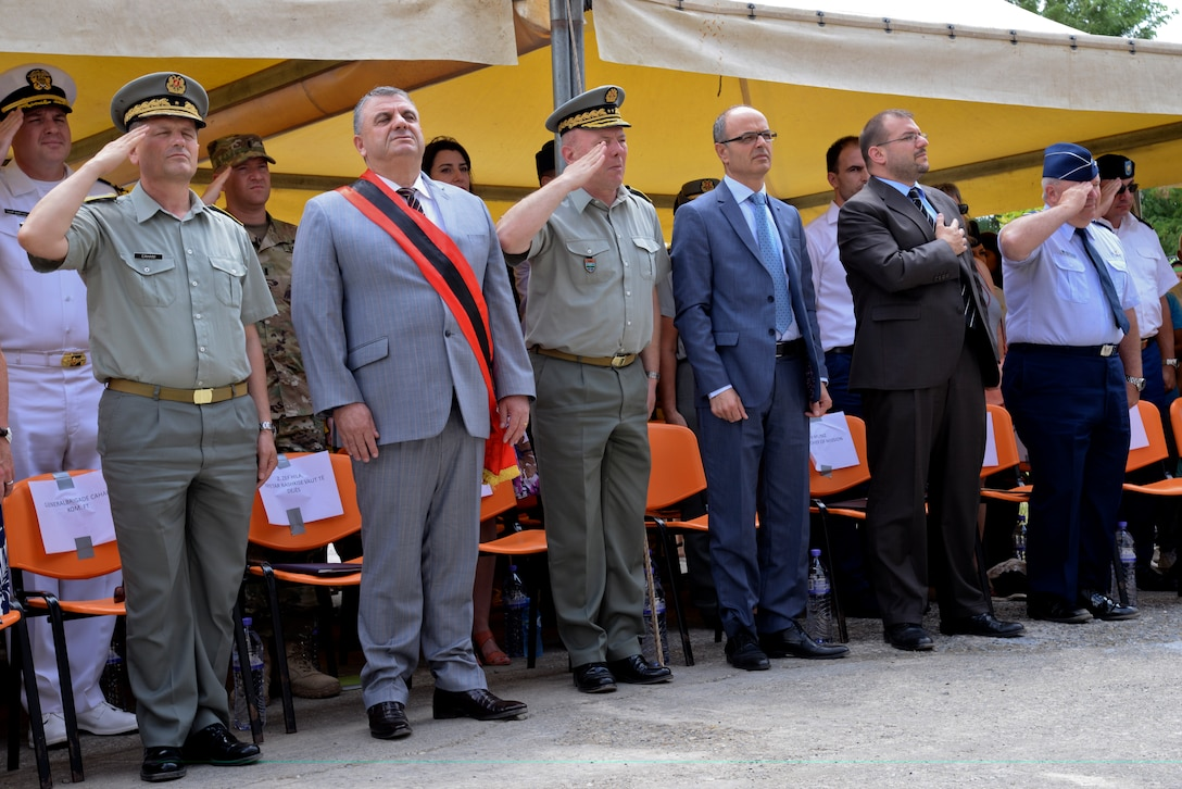 Civil Engineers from the New Jersey Air National Guard, members of the U.S. Army's 457th Civil Affairs Battalion and unit members of the Albanian Army land forces pose for a group photo prior to an inauguration ceremony marking the completion of renovation of the 12 year school in Mjede, Albania on July 15, 2016. The partial renovation of the school was made possible by the European Commands' Humanitarian Civic Assistance (HCA) program of the United States Department of Defense. The 177th Fighter Wing members were on a two week a deployment for training and teamed up with Albanian Army land forces unit members from the 1st Infantry Battalion in Vau i Dejës, Albania, and worked on plumbing, electrical, ceramic tile, roofing, and door and frame maintenance and installations. New Jersey and Albania are paired under the National Guard's State Partnership Program and are a proven partnership built upon shared values, experiences and vision. (U.S. Air National Guard photo by Master Sgt. Andrew J. Moseley/Released)