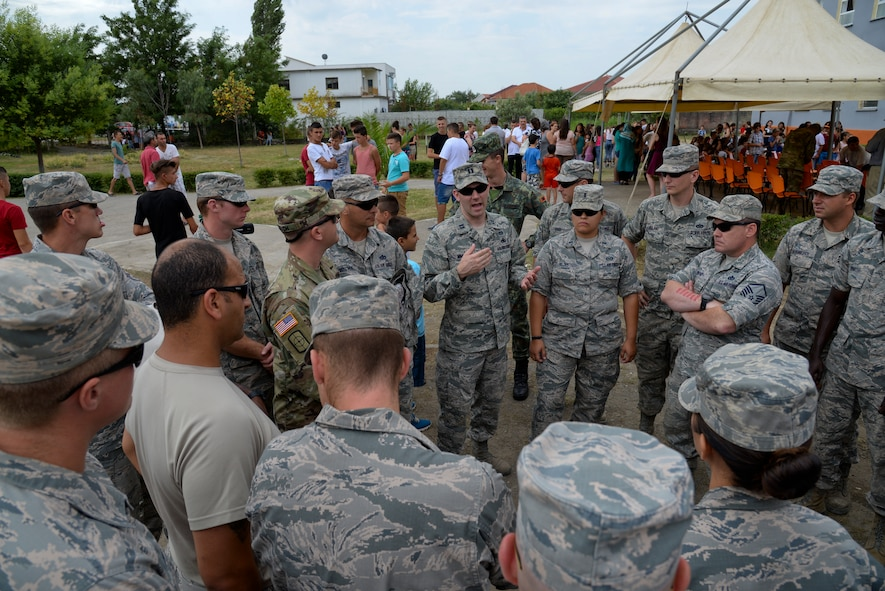 U.S. Air Force Capt. Andrew Matejek, civil engineer with the New Jersey Air National Guard, speaks to his airmen prior to an inauguration ceremony marking the completion of renovation of the 12 year school in Mjede, Albania on July 15, 2016. The partial renovation of the school was made possible by the European Commands' Humanitarian Civic Assistance (HCA) program of the United States Department of Defense. The 177th Fighter Wing members were on a two week a deployment for training and teamed up with Albanian Army land forces unit members from the 1st Infantry Battalion in Vau i Dejës, Albania, and worked on plumbing, electrical, ceramic tile, roofing, and door and frame maintenance and installations. New Jersey and Albania are paired under the National Guard's State Partnership Program and are a proven partnership built upon shared values, experiences and vision. (U.S. Air National Guard photo by Master Sgt. Andrew J. Moseley/Released)