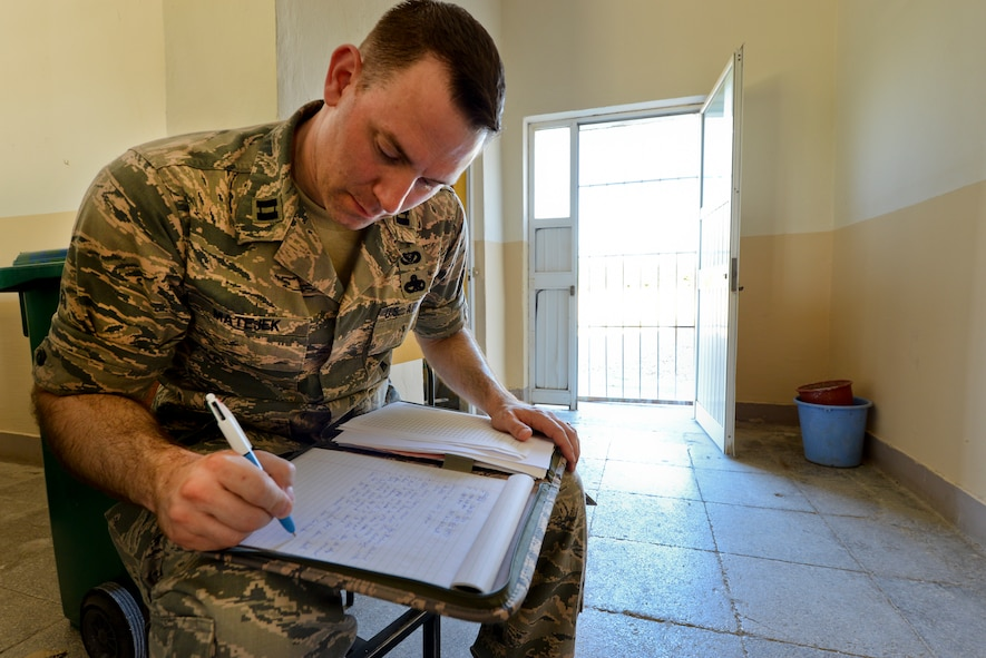 U.S. Air Force Capt. Andrew Matejek, New Jersey Air National Guard civil engineer, goes over a material list for Humanitarian and Civic Assistance renovation projects to be completed during the unit's Deployment For Training to Vau i Dejës, Albania on July 6, 2016. The 177th Fighter Wing civil engineers' planned projects include plumbing, electrical, ceramic tile, roofing, and door and frame maintenance and installations at a local medical clinic and a school in the nearby municipality of Mjede. New Jersey and Albania are paired under the National Guard's State Partnership Program and are a proven partnership built upon shared values, experiences and vision. (U.S. Air National Guard photo by Master Sgt. Andrew J. Moseley/Released)