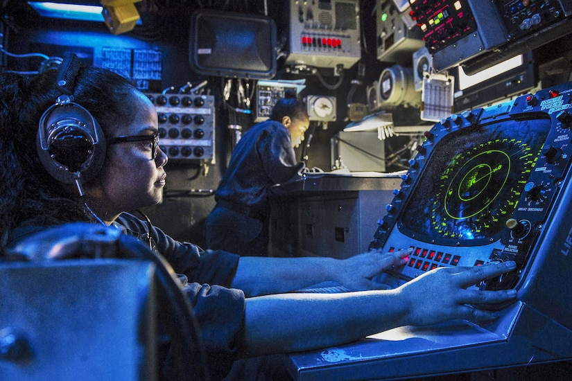 Sailor stands watch in combat information center on dock landing ship USS Harpers Ferry in South China Sea, August 4, 2016, supporting security in Indo-Asia-Pacific region (U.S. Navy/Zachary Eshleman)