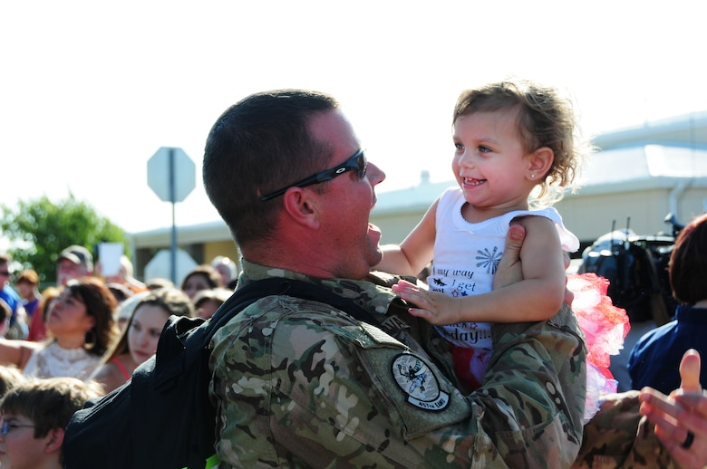 FORT WORTH, Texas - A 301st Fighter Wing Airman greets his daughter Aug. 8 at Naval Air Station Fort Worth Joint Reserve Base during the 301st Fighter Wing Homecoming from Operation Freedom's Sentinel.  Operation Freedom's Sentinel aims to maintain security and stability in Afghanistan.  (U.S. Navy photo by Mass Communication Specialist 2nd Class Jason Howard/Released)