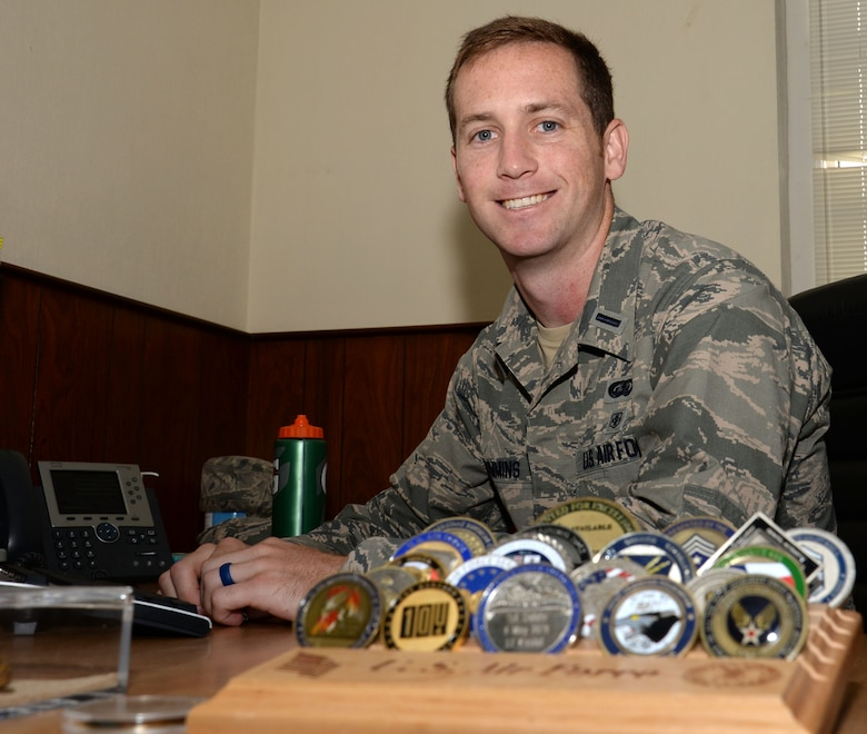 U.S. Air Force 1st Lt. Micah Cummins, 100th Air Refueling Wing chief of protocol, poses for a photograph in his office Aug. 3, 2016, on RAF Mildenhall, England. Cummins' father was a coach for youth soccer at night and he taught his son a sport that he still enjoys many years later. (U.S. Air Force photo by Gina Randall)