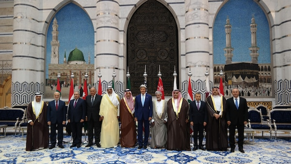U.S. Secretary of State John Kerry poses for a photo with Gulf Cooperation Council (GCC) and Regional Partners meeting participants in Jeddah, Saudi Arabia on September 11, 2014. [State Department photo/ Public Domain]