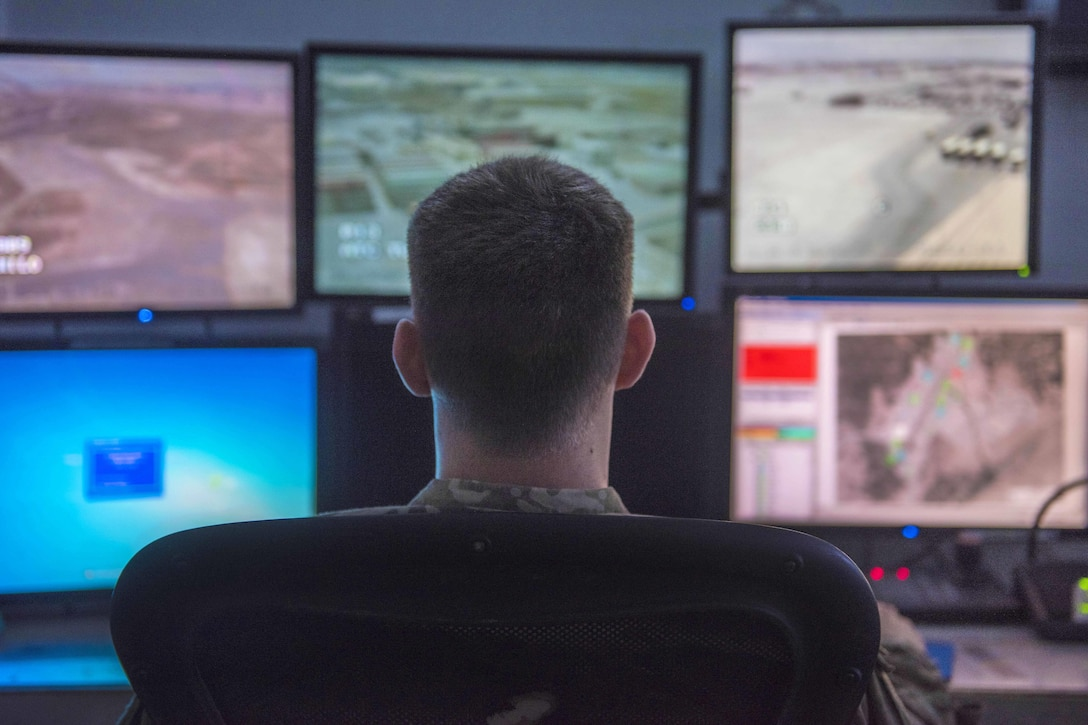 Air Force Staff Sgt. Dakota Karlsen watches multiple monitors of the area around the base at Bagram Airfield, Afghanistan, Aug. 4, 2016. Karlsen is a sector controller assigned to the 455th Expeditionary Security Forces Squadron. Air Force photo by Senior Airman Justyn M. Freeman