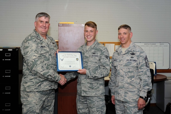 Senior Airman Jonathan Little, 22nd Comptroller Squadron financial analyst, poses with Col. Albert Miller, 22nd Air Refueling Wing commander, and Chief Master Sgt. Shawn Hughes, 22nd ARW command chief, Aug. 1, 2016, at McConnell Air Force Base, Kan. Little received the spotlight performer for the week of June 13-17. (U.S. Air Force photo/Airman 1st Class Jenna Caldwell)