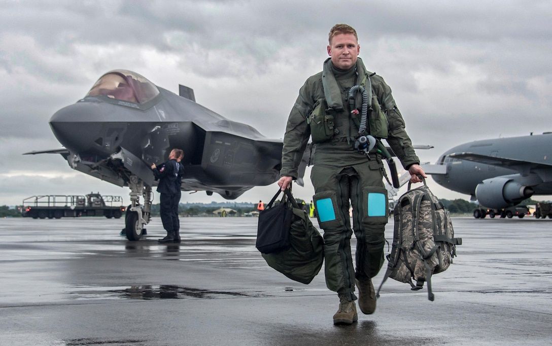 Maj. Daniel Daehler, 944th Operations Group Det. 2, F-35 instructor pilot, walks off the flightline at Royal Air Force Fairford, England, after flying a F-35 Lightning II from Luke Air Force Base, Arizona, to RAF Fairford making it his first trans-Atlantic flight and the first U.S. Air Force F-35 trans-Atlantic flight. The trip to the United Kingdom was in support of the Royal International Air Tattoo at Fairford in southern England. The group from Luke flew three F-35's to the air show allowing the crowds to witness an aerial performance and were able to get up close to the aircraft with a static display. (U.S. Air Force photo by Tech. Sgt. Jarad Denton)