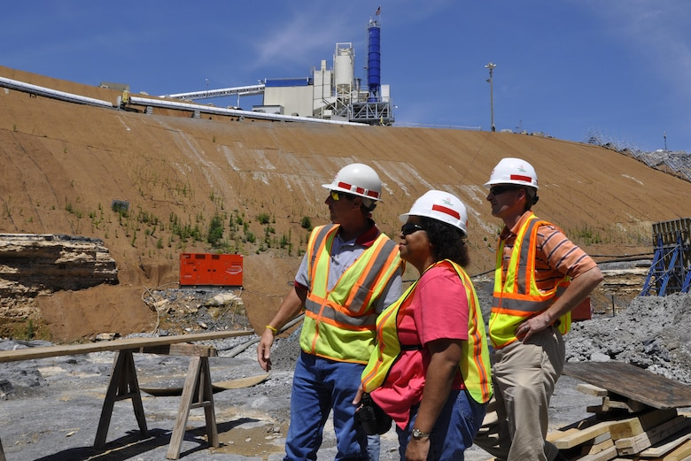 Tony Ellis (Left), Kentucky Lock Addition Project resident engineer, escorts Adrienne Gordon, U.S. Army Corps of Engineers Great Lakes and Ohio River Division, and Project Manager Adam Walker during a site visit June 13, 2012. Ellis, 53, passed away July 27, 2016.  Serving on the project since 2000, his leadership and expertise are being recognized for the project's success.