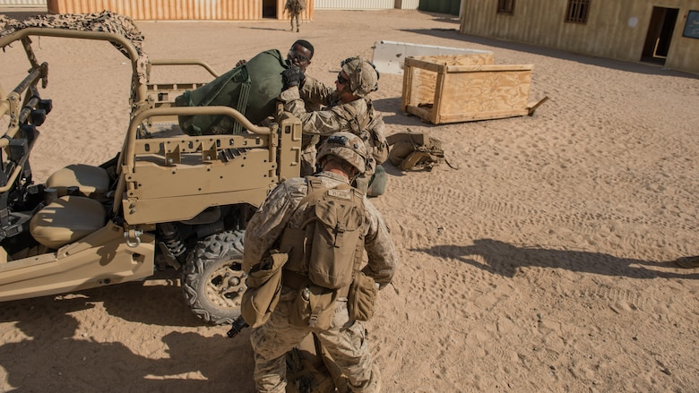 A group of Marines with Kilo Company, 3rd Battalion, 5th Marine Regiment offloading the Polaris MRZR after a mounted patrol throughout the town during the Marine Air Ground Task Force Integrated Experiment 2016 at Marine Corps Air Ground Combat Center Twentynine Palms, Calif.  July 29, 2016. During the exercise Marines had to maintain combat efficiency while sustaining their own food, water, electricity, and security without help from outside forces.