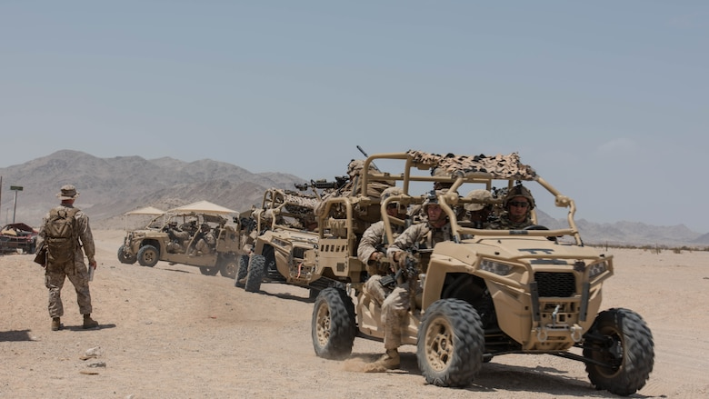A group of Marines with Kilo Company, 3rd Battalion, 5th Marine Regiment mounting up on the Polaris MRZR after a patrol throughout the town during the Marine Air Ground Task Force Integrated Experiment 2016 at Marine Corps Air Ground Combat Center Twentynine Palms, Calif.  July 31, 2016. The Marines had to go from building to building to ensure that the oppositional force was eliminated before moving on.