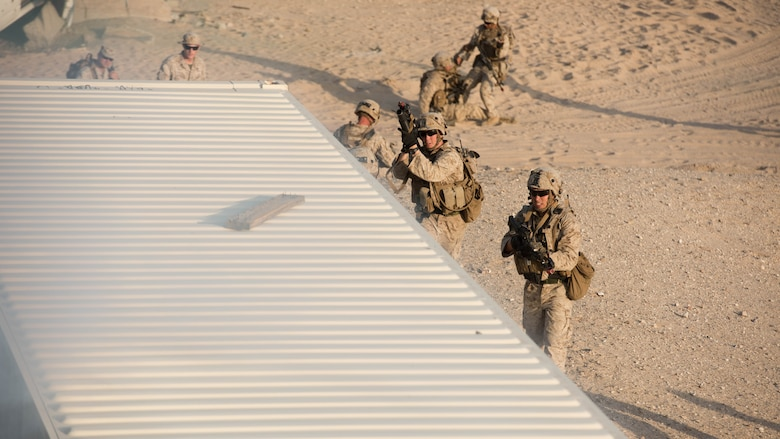 A group of Marines with Kilo Company, 3rd Battalion, 5th Marine Regiment attacking the oppositional force headquarters during the Marine Air Ground Task Force Integrated Experiment 2016 at Marine Corps Air Ground Combat Center Twentynine Palms, Calif. as part of the final course of action for the exercise.  July 31, 2016. The Marines used everything they learn throughout the course of the exercise to secure the enemy headquarters.