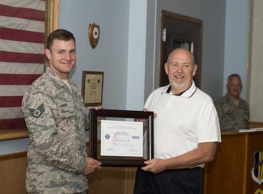 Staff Sgt. Jake Giovati presents his Civilian employer, Lt. Robert Sullivan of Wilmorite Security, Rochester, N.Y., with the ESGR (Employer Support of the Guard and Reserve) Patriot Award. The award is meant to recognize Civilian employers who go above and beyond to support their employees who serve in the Guard and Reserve. August 7, 2016, Niagara Falls Air Reserve Station, N.Y. (U.S. Air Force photo by Tech. Sgt. Stephanie Sawyer)