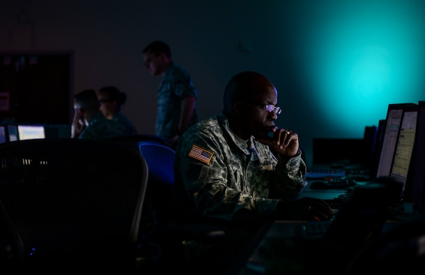 A soldier works at his desk in the mezzanine during a Blue Flag exercise at the 505th Combat Training Squadron at Hurlburt Field, Fla., July 22. The purpose of a Blue Flag exercise is to provide a Numbered Air Force the environment to train as the air and space component of a joint force by planning air and space operations and producing Air Tasking Orders and other supporting products for a given conflict. (U.S. Air Force photo by Airman 1st Class Nathan Byrnes)