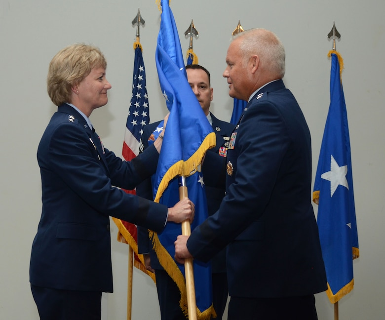 Lt. Gen. Maryanne Miller, Chief of Air Force Reserve, Commander Air Force Reserve Command, hands the guidon for the 22nd Air Force to Maj. Gen. John Stokes, giving him command of the unit during a change of command ceremony in Atlanta, Ga., on Aug. 8, 2016. Stokes assumed command of the 22n AF from Maj. Gen. Stayce Harris.(U.S. Air Force photo/Don Peek)