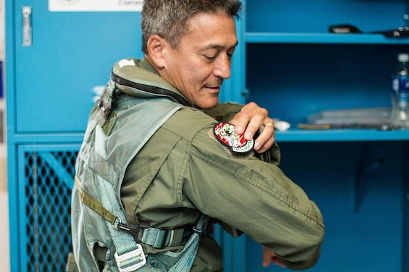 Maj. Gen. Michael Kim, mobilization assistant to Air Force Reserve commander, puts on a 457th Fighter Squadron patch as he prepares for his F-16 Fighting Falcon flight Aug. 8, 2016, at Naval Air Station Fort Worth Joint Reserve Base, Texas.
