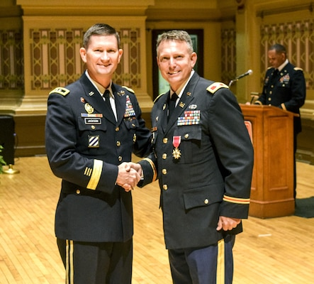 Upon his departure as the Pittsburgh District commander, Col. Bernard R. Lindstrom receives the Legion of Merit Award from Maj. Gen.  Donald E. (Ed) Jackson, Jr., July 29.