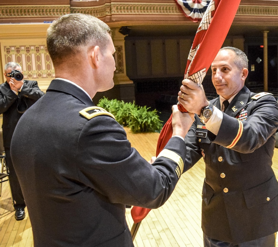In a traditional act that is rooted in military history dating back to the 18th century, Maj. Gen. Donald E. (Ed) Jackson, Jr., passed the command flag to Col. John P. Lloyd to symbolize the transfer of responsibility from one commander to another.