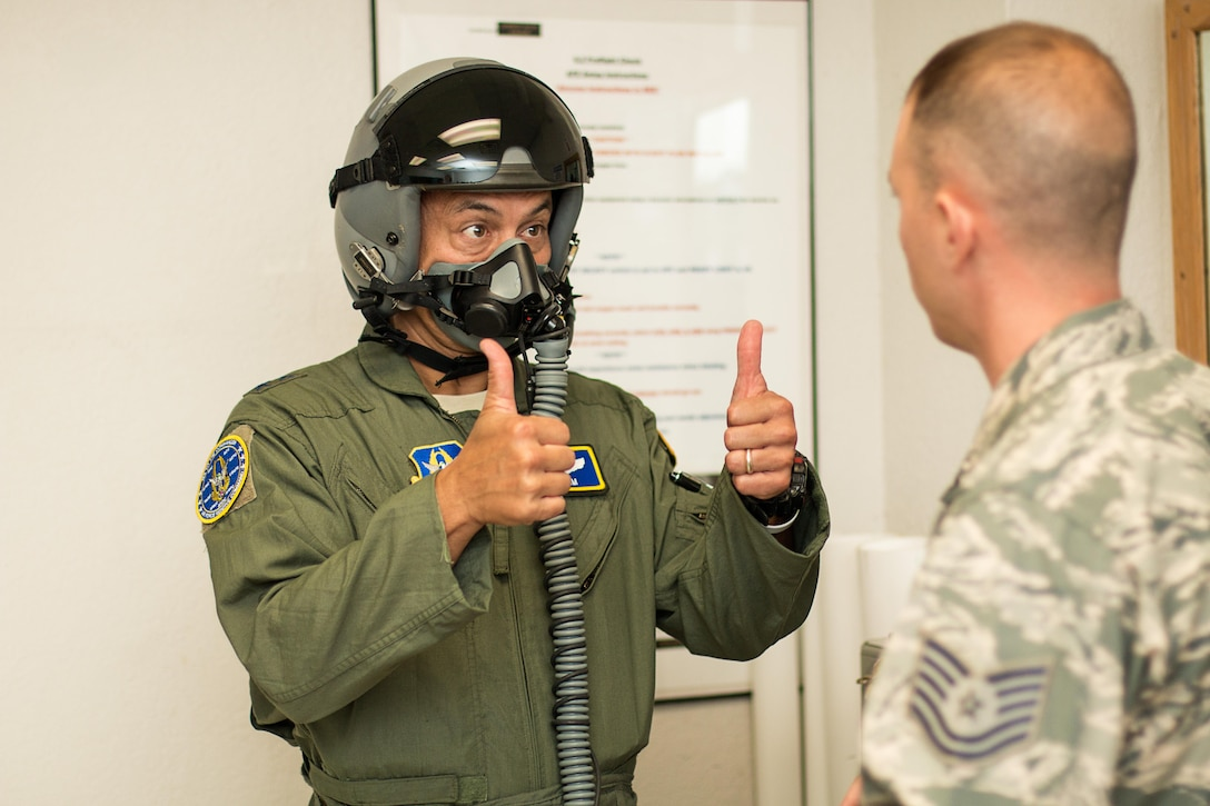 Maj. Gen. Michael Kim, mobilization assistant to the Air Force Reserve Command commander, provides thumbs up to Technical Sgt. Rudy Panacci, NCOIC, aircrew flight equipment, during preliminary fitting of helmet and mask prior to his incentive flight here Aug. 8, 2016.