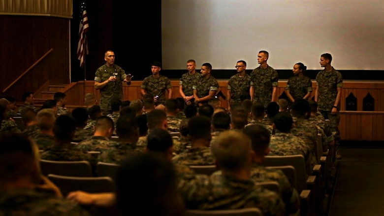 Navy Lt. Cmdr. David L. Duprey, left, a chaplain with the Marine Raider Support Group, demonstrates different levels of stress using several Marines from 8th Communication Battalion during a special readiness evolution at Camp Lejeune, N.C., August 3, 2016. Duprey, talked to the audience about the importance of intervening in the early stages of stress in order to mitigate future potential related issues. (U.S. Marine Corps photo by Pfc. Juan Soto-Delgado)