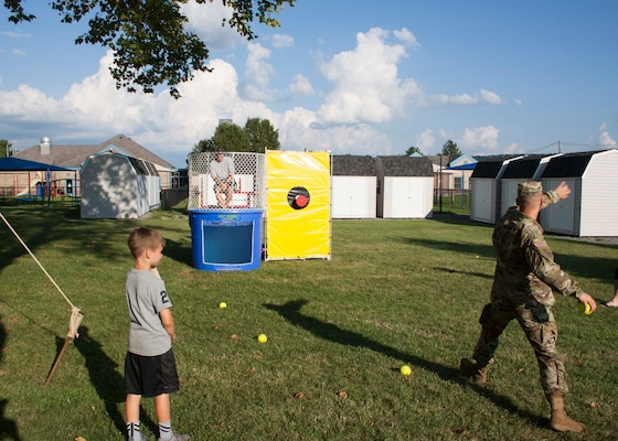 Army Col. Brad Eungard, commander of DLA Distribution Susquehanna, Pa., tries his hand at the dunk tank during Defense Distribution Center Susquehanna's National Night Out on Aug. 2.