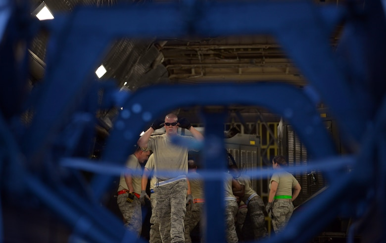 Airmen with the 28th Aircraft Maintenance Squadron load equipment onto a Dover Air Force Base (AFB), Del., C-5 Galaxy at Ellsworth AFB, S.D., Aug. 2, 2016. C-5's and 747's are transporting 650 tons of equipment to Guam in support of U.S. Pacific Command's continuous bomber presence mission where Ellsworth's B-1 bombers will provide the command with a credible, strategic power projection platform. (U.S. Air Force photo by Airman Donald Knechtel)