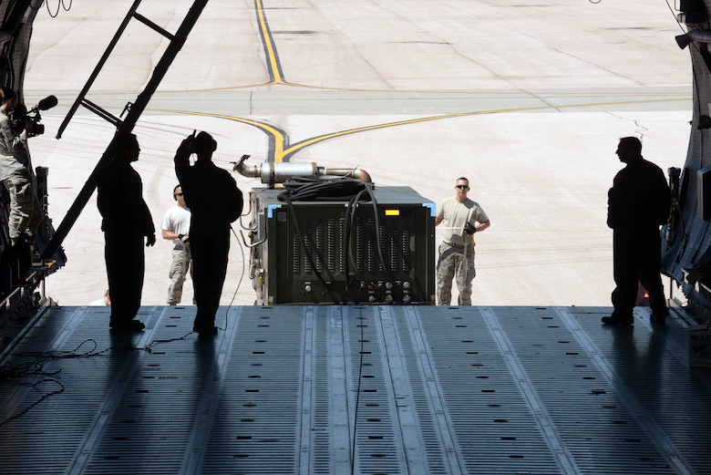 Airmen with the 28th Aircraft Maintenance Squadron load equipment into a C-5 Galaxy from Travis Air Force Base (AFB), Calif., at Ellsworth AFB, S.D., Aug. 4, 2016. The equipment is being transported from Ellsworth AFB to Andersen AFB, Guam, where it will be used to support B-1 bombers as they provide U.S. Pacific Command a global strike and extended deterrence capability. (U.S. Air Force photo by Airman Donald Knechtel)