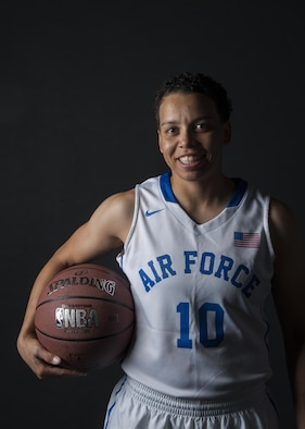 Senior Airman Avery Hale, 5th Maintenance Squadron aerospace ground equipment journeyman, holds a basketball in her Air Force basketball uniform at Minot Air Force Base, N.D., Aug. 8, 2016. Hale grew up playing basketball, and now plays for the U.S. Air Force women's team. (U.S. Air Force photo/Airman 1st Class Christian Sullivan)