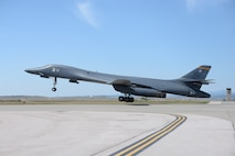 A B-1 bomber departs at Ellsworth Air Force Base (AFB), S.D., Aug. 5, 2016, as part of a deployment to Andersen AFB, Guam. More than 300 Airmen from the 28th Bomb Wing have deployed to Andersen AFB, Guam, in support of U.S. Pacific Command's continuous bomber presence mission. (U.S. Air Force photo by Airman 1st Class Sadie Colbert)