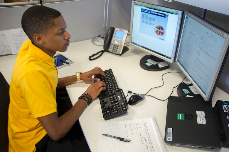 Jonathan Beckett a Summer Pathways intern at Joint Base Andrews, Md., responds to an email from his workstation. Beckett is currently interning at the Air Force District of Washington Financial Management section.(Photo by U.S. Air Force Senior Master Sgt. Adrian Cadiz)(Released)