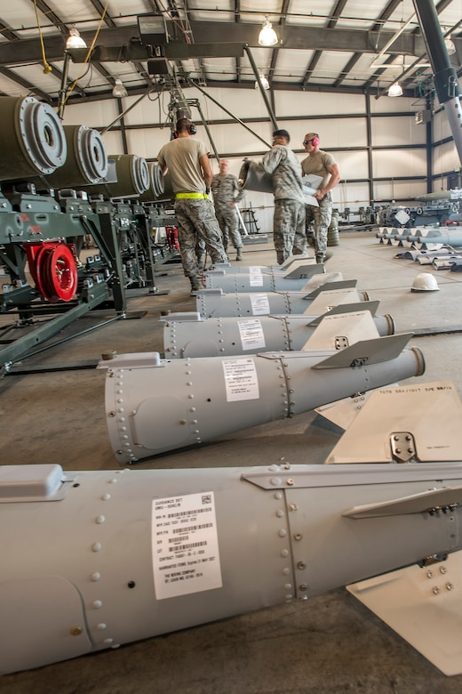 Airmen from the 325th Maintenance Squadron, Tyndall Air Force Base, Fla., lift a GBU-32 bomb tail section onto the primary bomb body Aug. 2 at Hill AFB, Utah. The bombs being assembled will be dropped later by aircraft participating in exercise Combat Hammer at Hill AFB and the Utah Test and Training Range. (U.S. Air Force photo by Paul Holcomb)