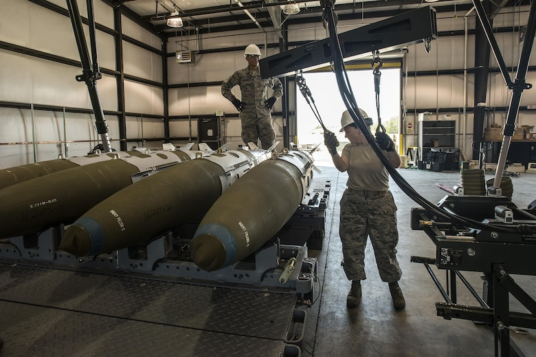 Staff Sgt. Kimber Bergstrom, 325th Maintenance Squadron, Tyndall Air Force Base, Fla., moves a hoist apparatus after loading GBU-32 bombs onto a trailer Aug. 2 at Hill AFB. The bombs will be used later during Combat Hammer, an exercise currently taking place at Hill AFB and the Utah Test and Training Range. (U.S. Air Force photo by Paul Holcomb)