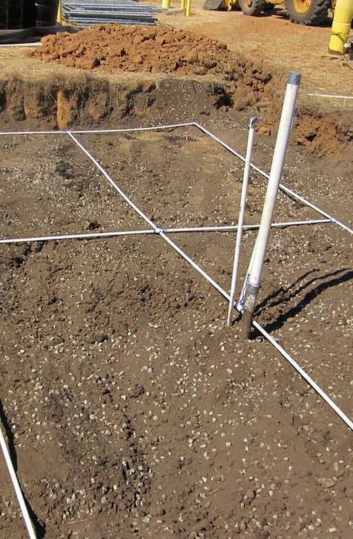 A bioreactors is installed to treat groundwater. The groundwater is pumped to the top of the bioreactor and allowed to percolate through layers of mulch, gravel, molasses, and vegetable oil. The molasses and vegetable oil act as nutrients for the microbes that breakdown the chlorinated solvents. (Courtesy photo)