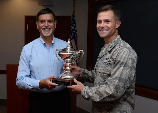 Randy Brown (left), U.S. Air Force Civil Engineer Center director, presents the 2016 Department of Defense Environmental Award for Environmental Restoration, Installation award to Col. Larry Broadwell, 9th Reconnaissance Wing commander, Aug 5, 2016, at Beale Air Force Base, California. Beale received the award for making progress toward cleaning contamination from past defense activities, maintaining partnerships to improve species habitat and minimizing groundwater contamination. (U.S. Air Force photo by Robert Scott)