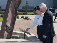 NORAD and USNORTHCOM Commander, Gen. Lori Robinson and the Honourable Stéphane Dion, Canadian Minister of Foreign Affairs, pause in front of the 9/11 Memorial at the headquarters prior to the Minister receiving briefings on the commands' missions during his visit to Peterson Air Force Base, in Colorado Springs, Colorado, August 8, 2016.