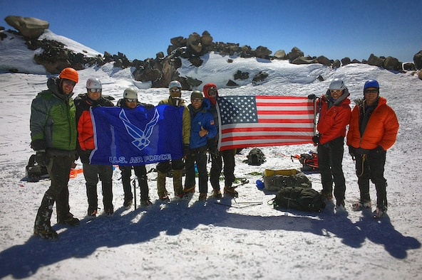 Members of the U.S. Air Force 50 Summits Challenge pose for a photo July 23, 2016, at the summit of Mount Rainier, Wash. Eight climbers from Joint Base Lewis-McChord summited the mountain to complete the summit challenge for Washington. (Courtesy photo)