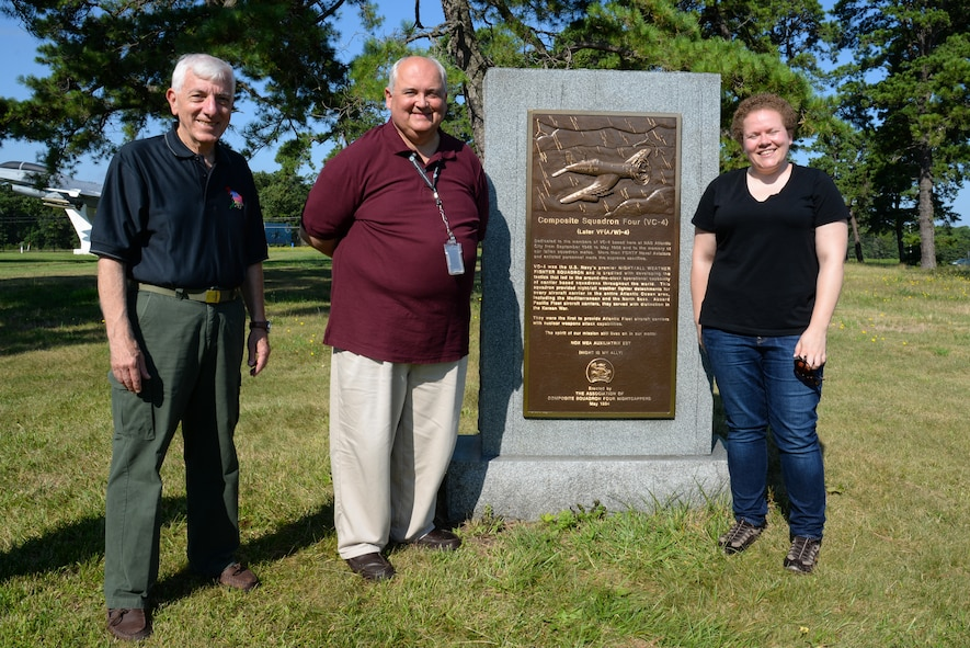 From right, Melissa Swanson, Naval History and Heritage Command Conservator, Stan Ciurczak, Management and Program Analyst with the FAA William J. Hughes Technical Center, and Dr. Richard Porcelli, local aviation historian, pose for a photo in front of a U.S. Navy VC-4 memorial marker at the Atlantic City Air National Guard base on July 20, 2016. The monument, located near the main gate of the 177th Fighter Wing of the New Jersey Air National Guard, was erected in May 1994 by the Association of The Composite Squadron Four Nightcappers, pays tribute to the members of the VC-4 Squadron based at Naval Air Station Atlantic City from September 1948 to May 1958 who gave the ultimate sacrifice. Ciurczak, the Tech. Center's unofficial historian, noticed that the monument was in need of attention and contacted Swanson, based out of Richmond, Virginia, who removed lichens growing on the sides and back of the granite monument and polished the bronze plaque. (U.S. Air National Guard photo by Master Sgt. Andrew J. Moseley/ Released)