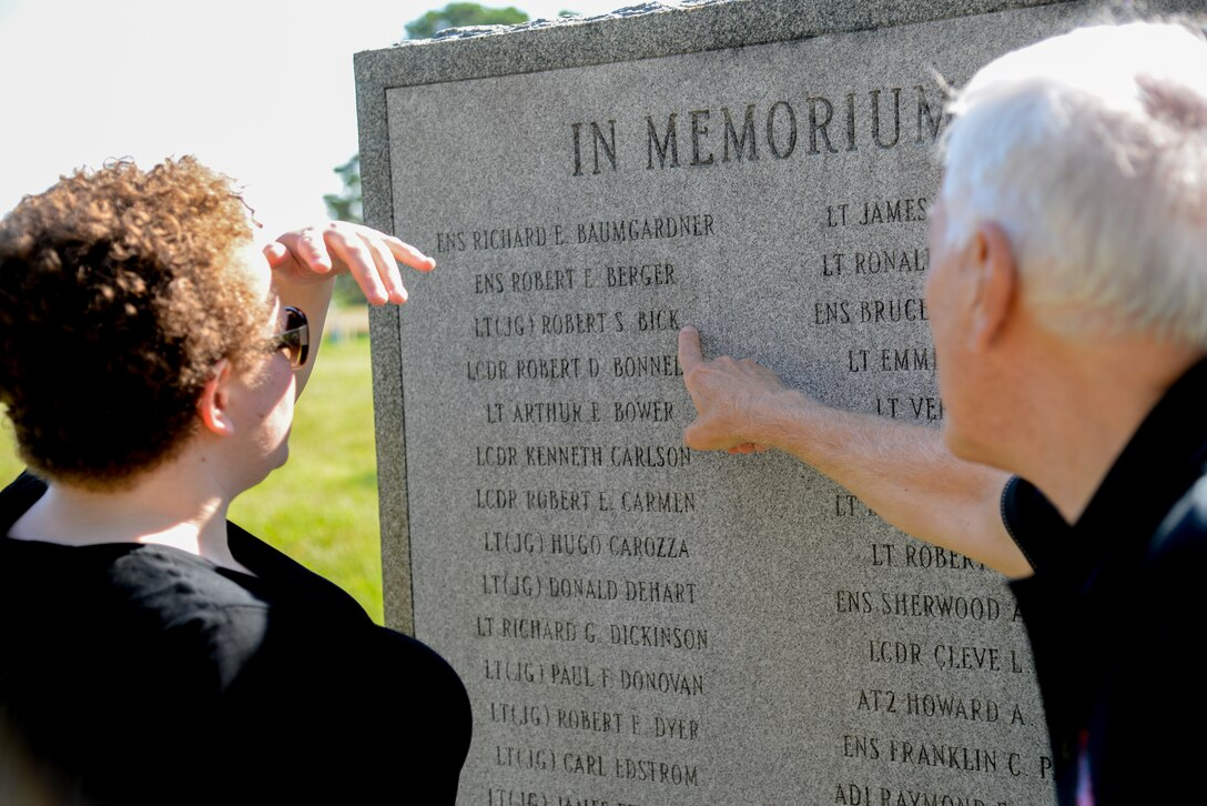 Dr. Richard Porcelli, local aviation historian, points out a name inscribed on a U.S. Navy VC-4 memorial marker to Melissa Swanson, Naval History and Heritage Command Conservator, at the Atlantic City Air National Guard base on July 21, 2016. The monument, located near the main gate of the 177th Fighter Wing of the New Jersey Air National Guard, was erected in May 1994 by the Association of The Composite Squadron Four Nightcappers and pays tribute to the members of the VC-4 Squadron based at Naval Air Station Atlantic City from September 1948 to May 1958 who gave the ultimate sacrifice. (U.S. Air National Guard photo by Master Sgt. Andrew J. Moseley/ Released)