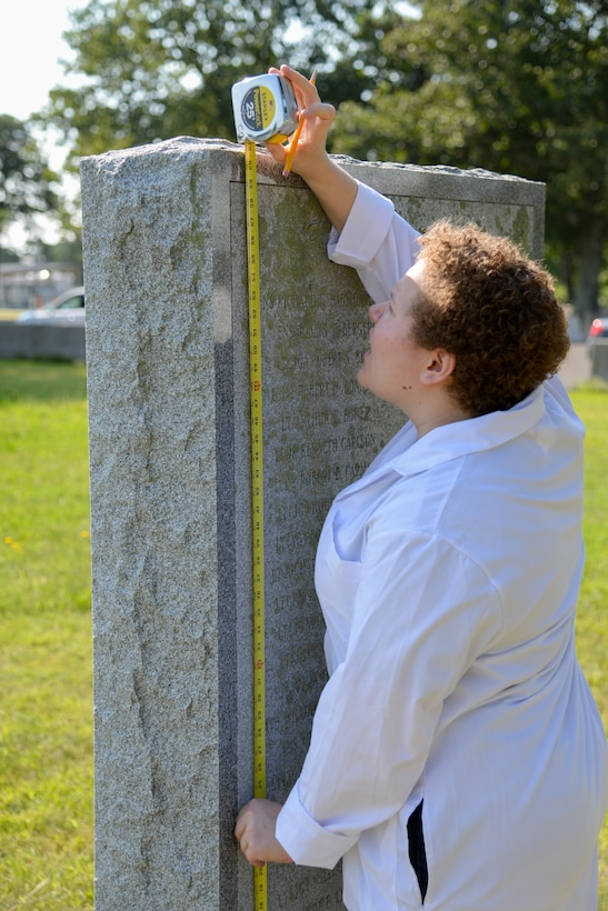 Melissa Swanson, Naval History and Heritage Command Conservator, takes measurements of a U.S. Navy VC-4 memorial marker, located near the main gate of the 177th Fighter Wing of the New Jersey Air National Guard in Egg Harbor Township, N.J., on July 20, 2016. The monument, erected in May 1994 by the Association of The Composite Squadron Four Nightcappers, pays tribute to the members of the VC-4 Squadron based at Naval Air Station Atlantic City from September 1948 to May 1958 who gave the ultimate sacrifice. Swanson, based out of Richmond, Virginia, removed lichens growing on the sides and back of the monument and polished the bronze plaque. (U.S. Air National Guard photo by Master Sgt. Andrew J. Moseley/Released)