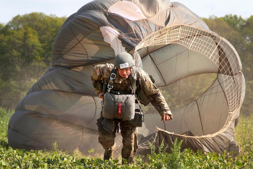 Army Warrant Officer Greg Suchanek drags his parachute toward a rally point during Leapfest 2016, an international parachut training event, in West Kingston, R.I., Aug. 4, 2016. Suchanek is a paratrooper assigned to Special Operations Detachment (NATO). The Rhode Island Army National Guard's 56th Troop Command hosted the event to promote high-level technical training and esprit de corps within the international airborne community. Army photo by Sgt. Brady Pritchett