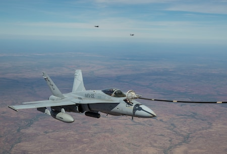 An F/A-18C Hornet with Marine Fighter Attack Squadron (VMFA) 122 conducts an aerial refueling with Marine Aerial Refueler Transport Squadron (VMGR) 152 during Exercise Pitch Black 2016 at Royal Australian Air Force Base Tindal, Australia, Aug. 9, 2016. VMGR-152 provides aerial refueling and assault support during expeditionary and joint or combined operations like Pitch Black. This exercise is a biennial, three week, multinational, large-force training exercise hosted by RAAF Tindal. (U.S. Marine Corps photo by Cpl. Nicole Zurbrugg)